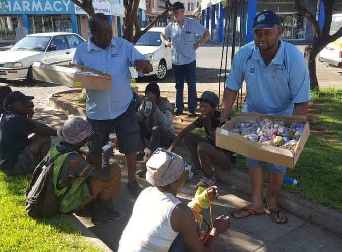 Members of SSVP hand out food to the homeless